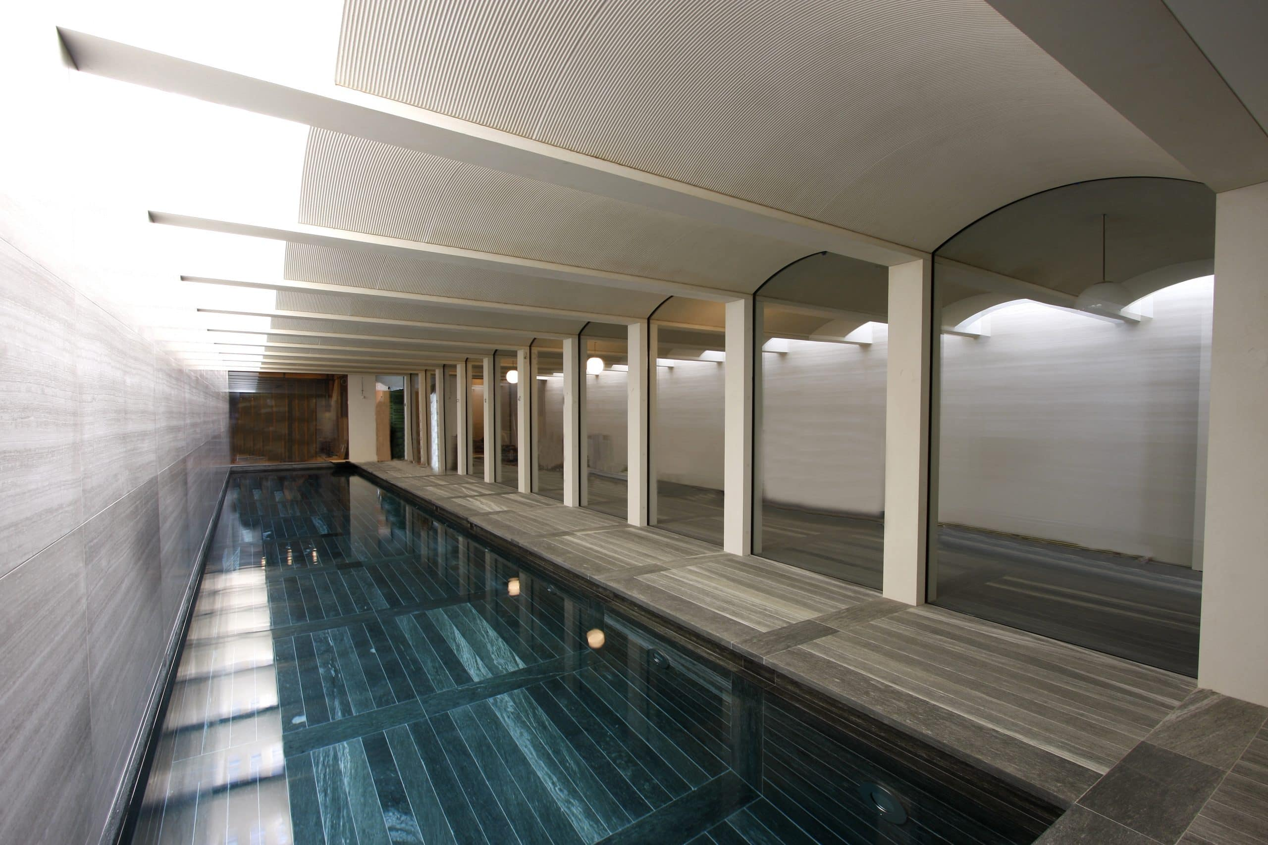 Canal House - heated glass in arch as focus by the indoor pool