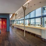 cocktail bar with large curved glass wall