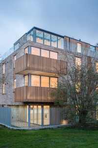 conemporary residential development with a moder rooftop extension made from glass