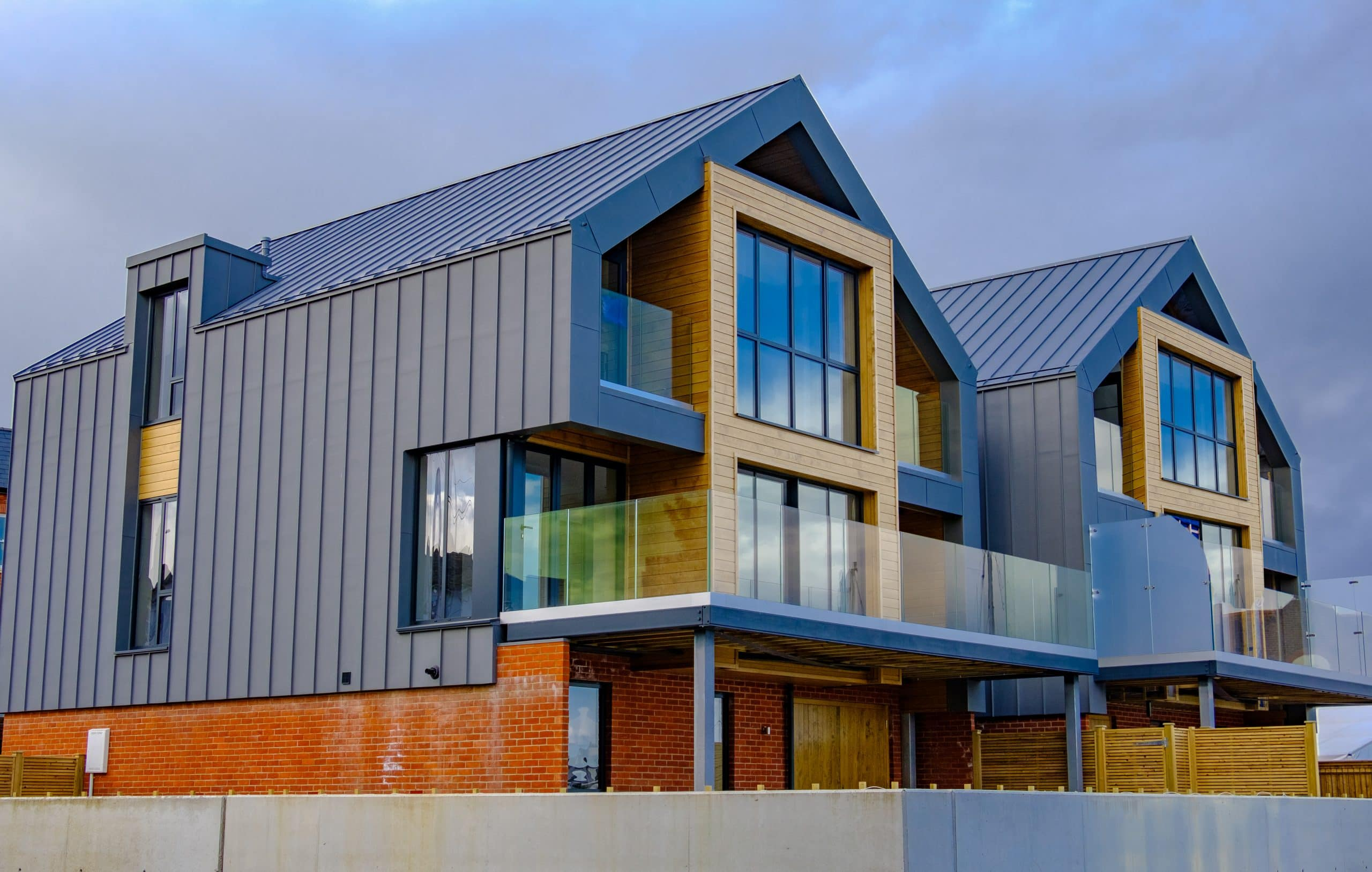 conservation area residential development by the coast using aluminium framed windows and doors