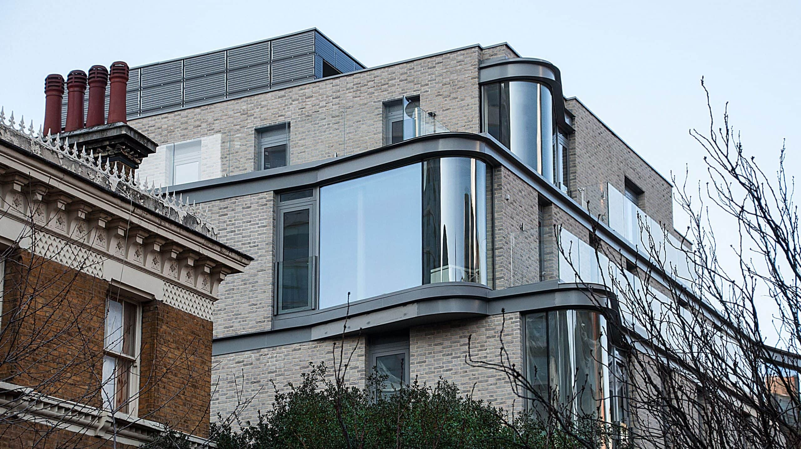 large windows with curved glass for clear panoramic views of the outdoors