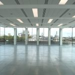 Large commercial building with floor to ceiling glazing systems