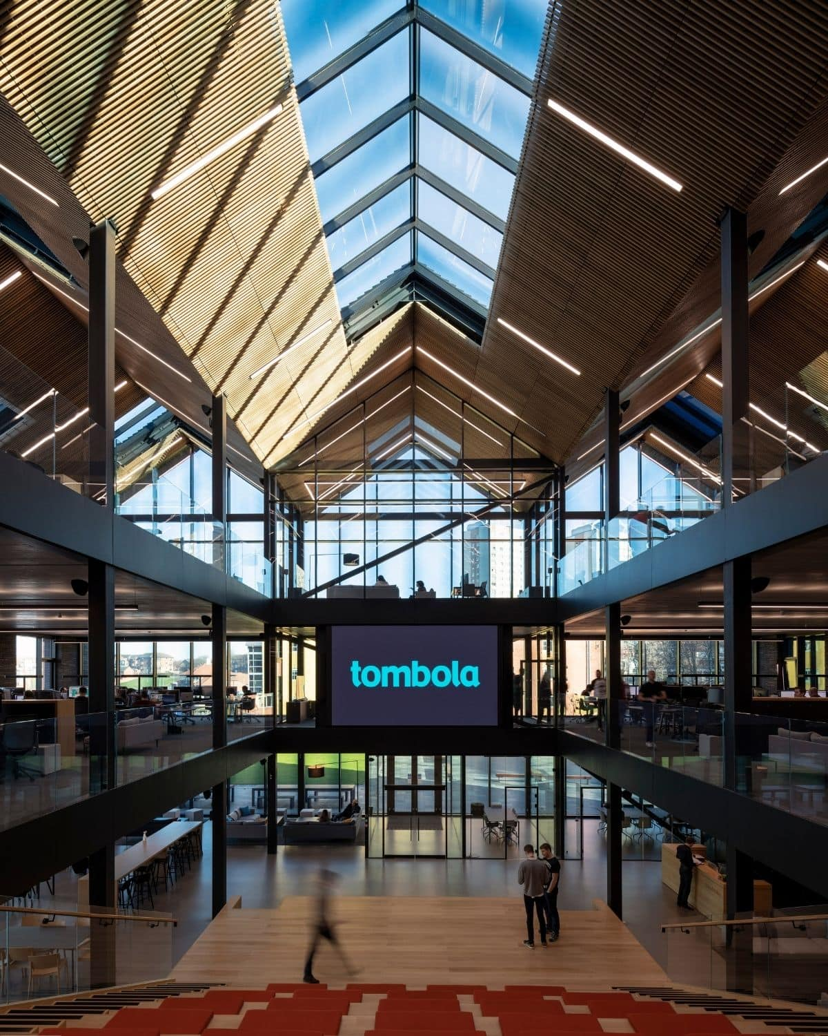 internal view of the tombola headquarters with large electrochromic glass facades