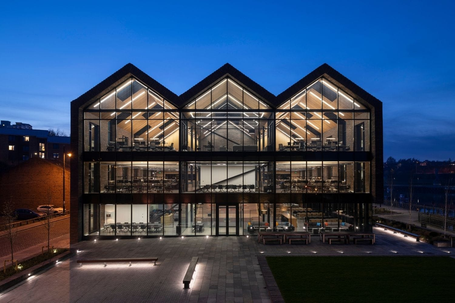 large commercial office building with a full glass façade of structural glazing with electrochromic glass