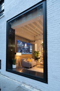 Oversized slim framed window in shop front design