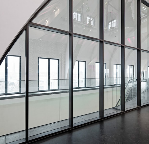 commercial space with large steel framed fire rated glass partition