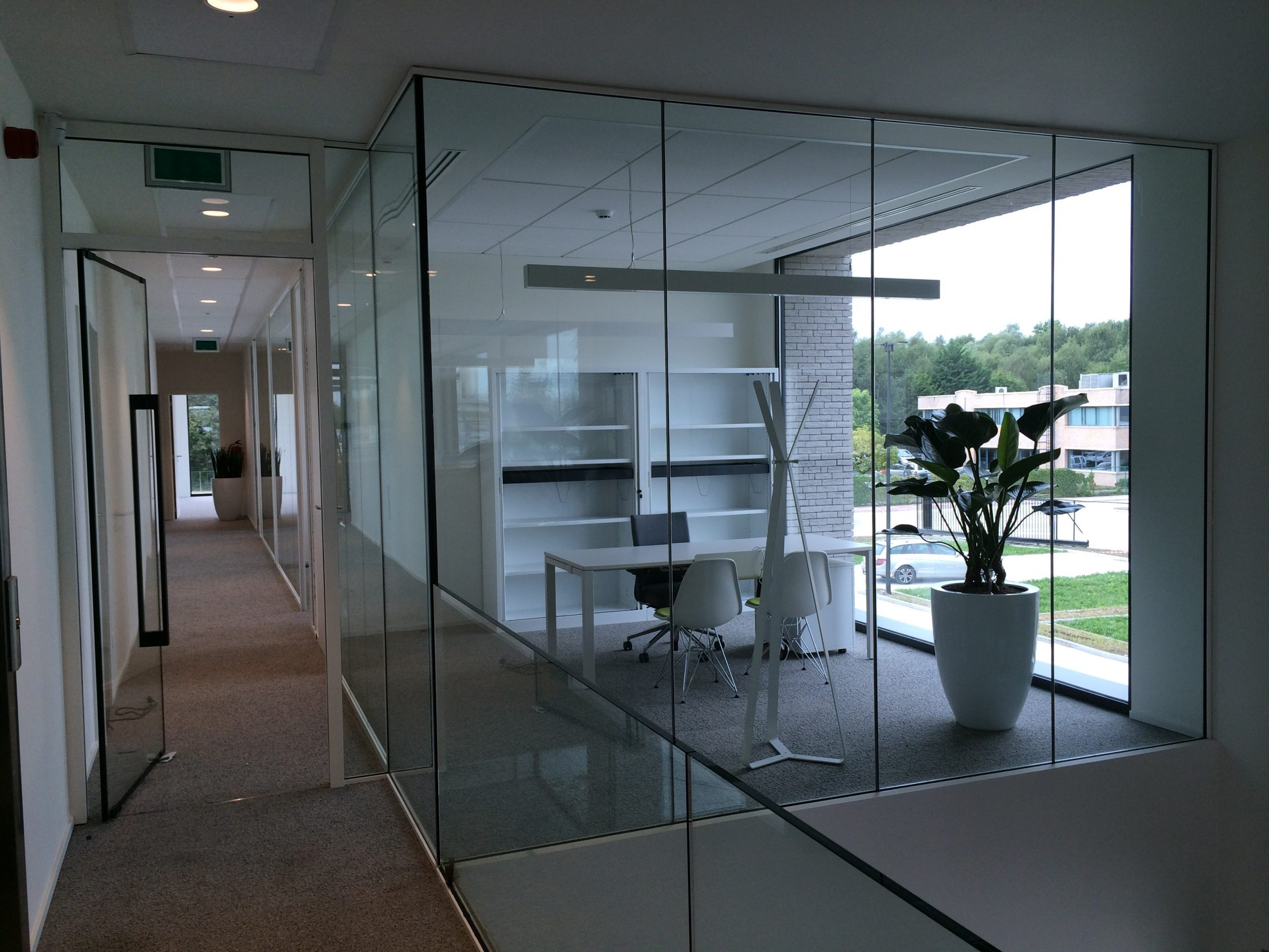 frameless fire rated glass partition in an office