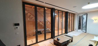 luxury home with frameless glass fire rated door and fire rated glass partitions