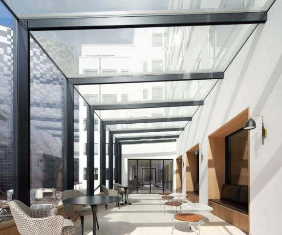 award winning commercial project with structural glass façade atria