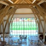 barn conversion into a modern wedding venue with double height triple glazing sliding doors