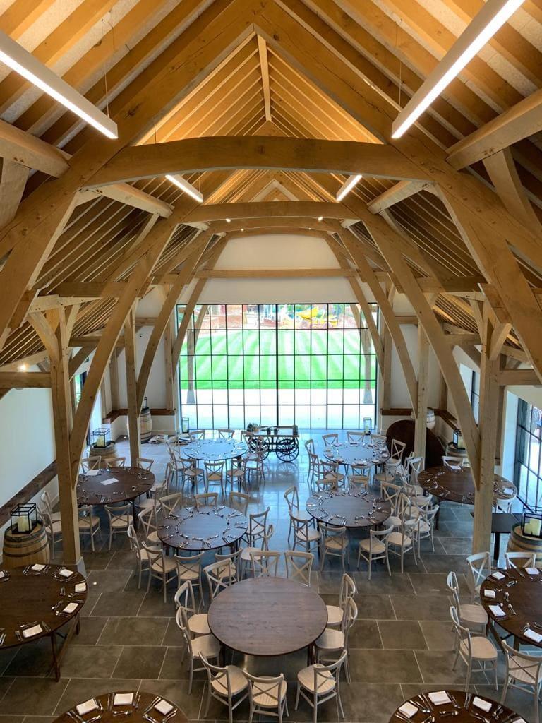 barn style wedding venue with minimal windows steel look sliding doors