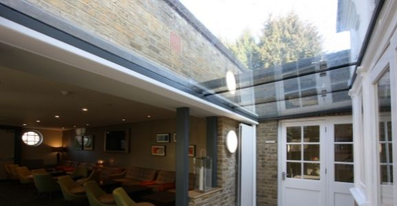 fire rated structural glass ceiling in a hospitality commercial building