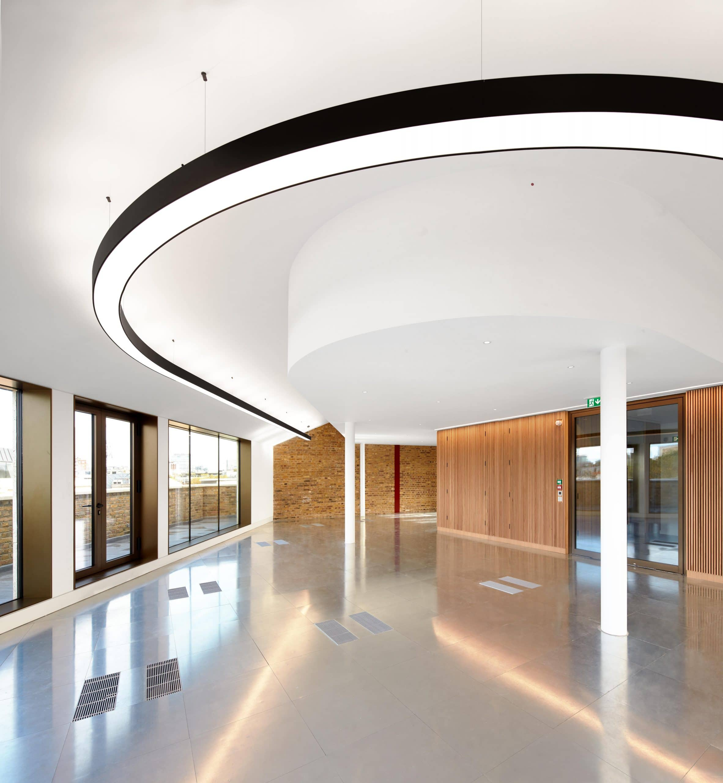 Frameless glass walls with glass door systems in a modern commercial office