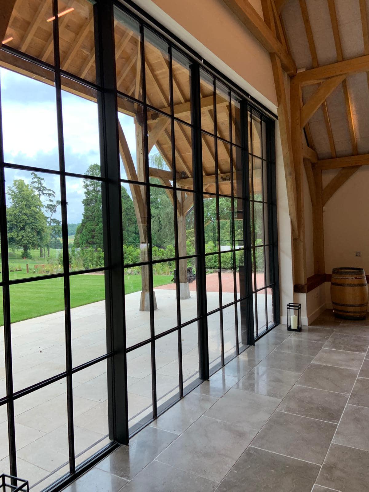 oversized slim sliding doors with glazing bars from minimal windows