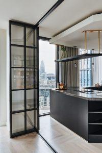 Slim framed aluminium bifolds with glazing bar design