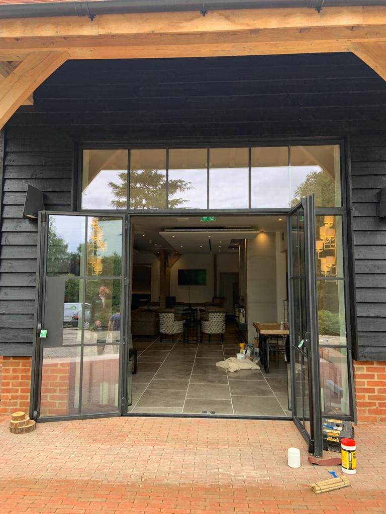 steel framed doors with fixed sidelights in a modern wedding venue
