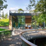 treetop walkway leading to highly glazed building at the newt banner image