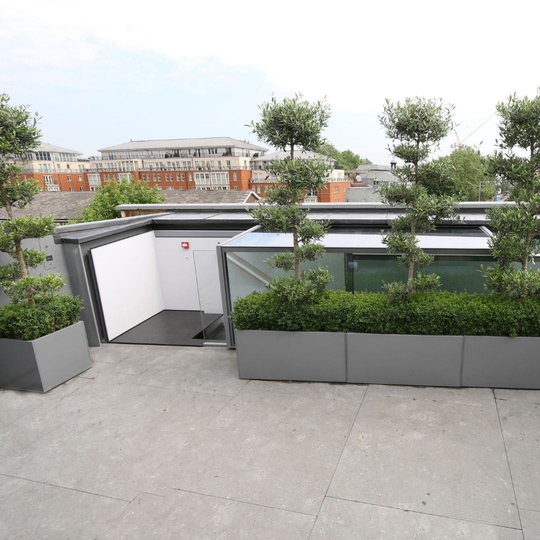 automated sliding box rooflight as a commercial rooftop access rooflight