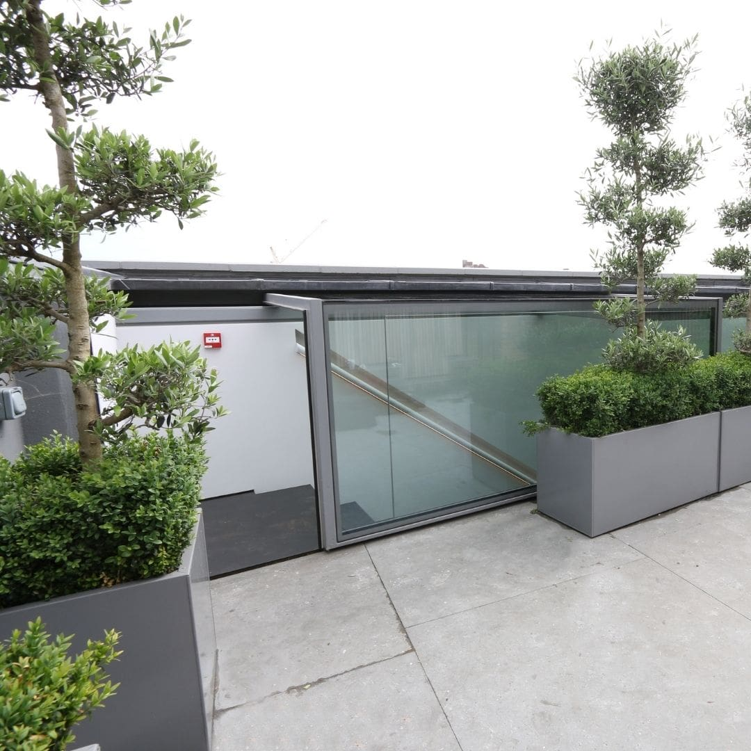 commercial roof terrace with sliding box access rooflight