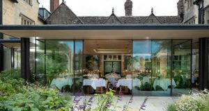 highly glazed extension with slim sliding doors on a listed hotel called Gravetye Manor