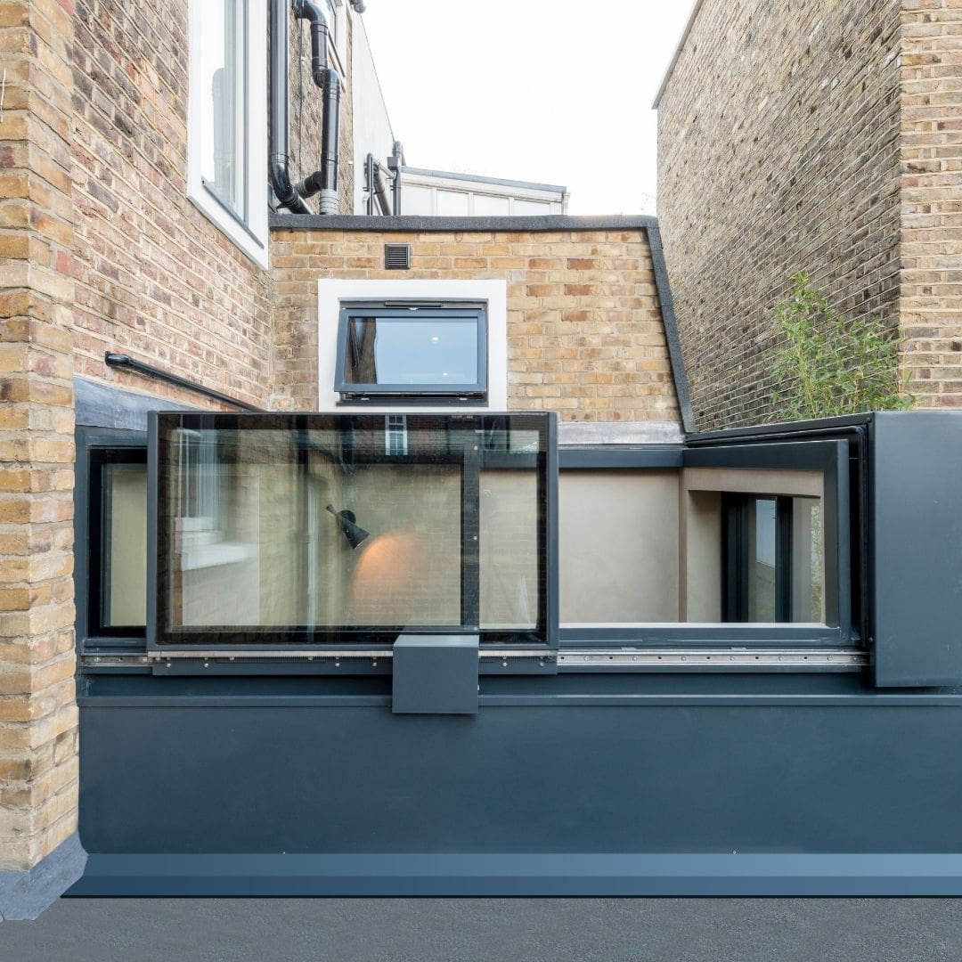 sliding box rooflight used in a central London home renovation to increase natural light and ventilation