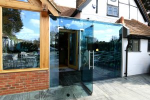 structural glass lobby installed at the front of a restaurant