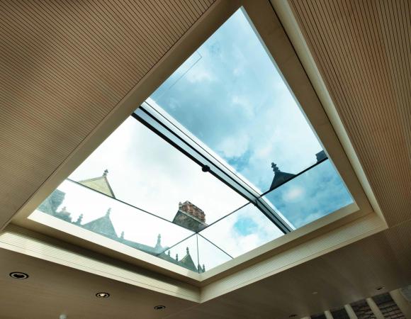Automated frameless glass sliding rooflight
