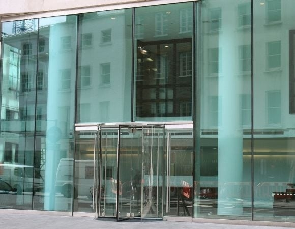 commercial glazing project on the front of a london office with full glass facade that has a sleek and minimal design