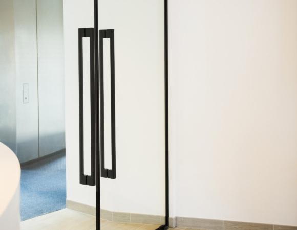 Frameless fire rated door