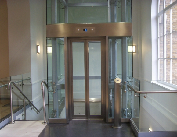 internal glass lift shaft with fire rated glass