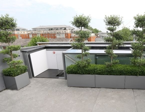 sliding box rooflight used for roof access in a commercial roof terrace